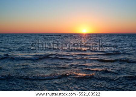 Sunset On The Blue Sea