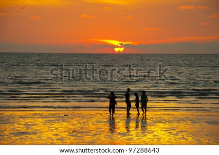 Sunset on the golden beach - stock photo