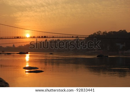 Sunset on the holy Ganges river - stock photo
