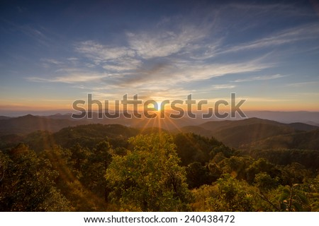 Sunset on the horizon in a peaceful valley, Chiang Mai, Thailand. - stock photo
