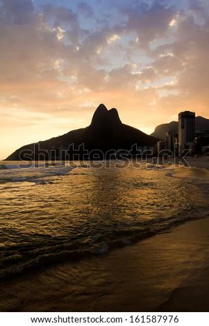 Sunset on the Ipanema Beach, Rio de Janeiro, Brazil. - stock photo
