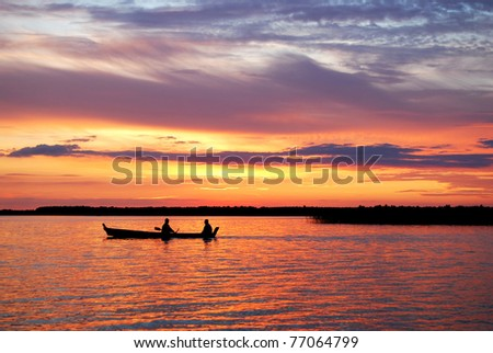 sunset on the lake, boat silhouette