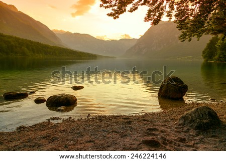 Sunset on the lake Bohinj in Triglav national park, located in the Bohinj Valley of the Julian Alps. - stock photo