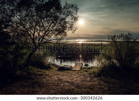 Sunset on the lake. Lake Naroch, Belarus. - stock photo