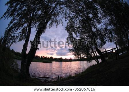 Sunset on the lake, Mozhga, Udmurt Republic, Russia, - stock photo