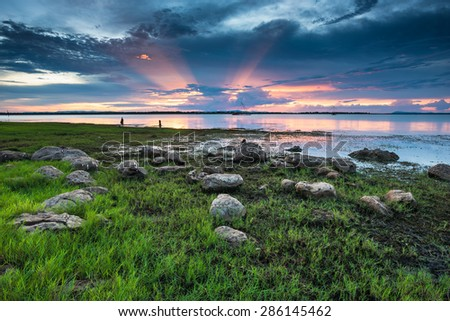 Sunset on the lake with beautiful sky - stock photo