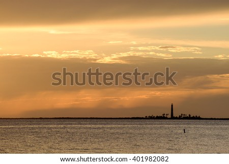 Sunset on the Loggerhead Key Lighthouse in the Dry Tortugas - stock photo