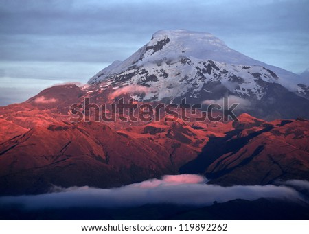 Sunset on the mighty Volcano Cayambe in Ecuador - stock photo