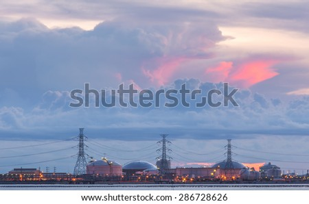Sunset on the petrochemical plants - stock photo