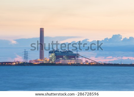Sunset on the power plants - stock photo