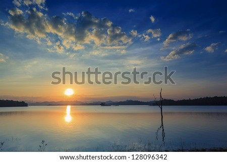 sunset on the river and wooden - stock photo