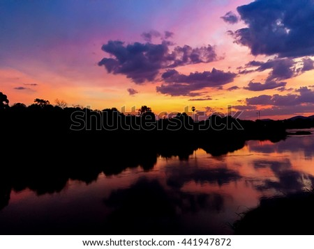Sunset on the river, Reflection water, Colorful sky and  silhouette - stock photo