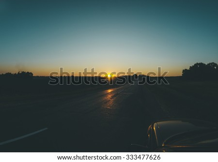 Sunset on the road, photo with car - stock photo
