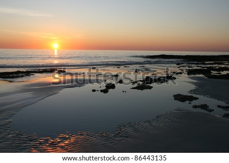 Sunset on The Rocks, Cable Beach, Broome, Australia - stock photo