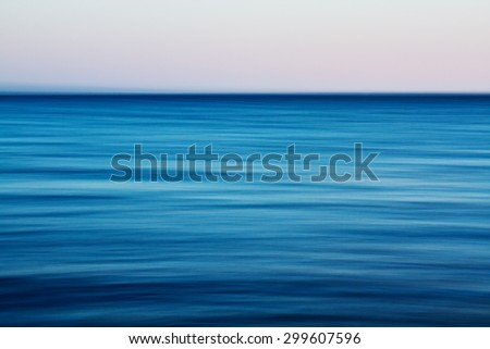 sunset on the sea, motion blurred effect, natural photograph - stock photo