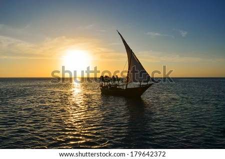 Sunset on the sea with a Dhow, the traditional boat in Zanzibar, Tanzania
