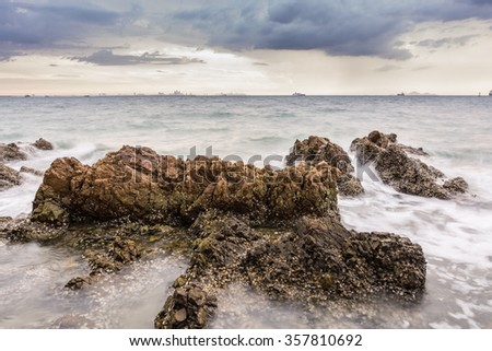 Sunset on the sea with Rocks stone - stock photo