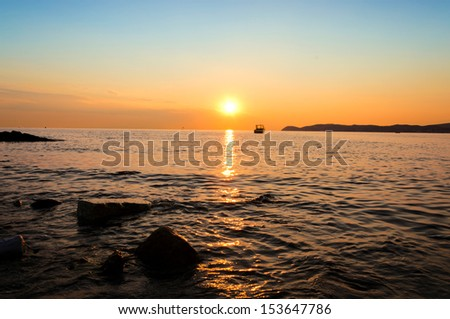 Sunset on the seaside in Thassos island. Selective focus on the sea and sun
