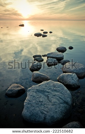 sunset on the shoreline - stock photo