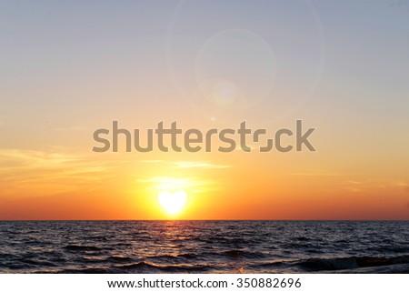 Sunset on the summer beach - stock photo