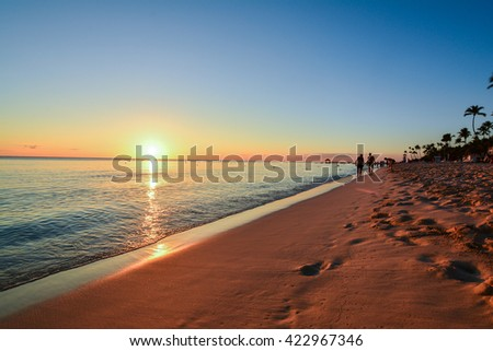 sunset on the tropical island of the Caribbean with palm trees and white beaches Bayahibe punta cana dominican republic - stock photo
