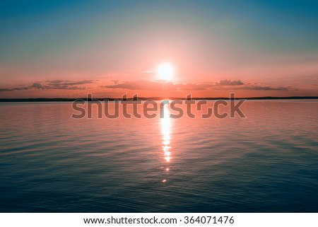 Sunset on the water in the sea - stock photo