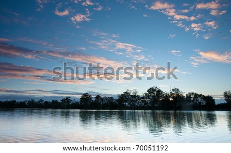 sunset on the water of the river murray south australia - stock photo