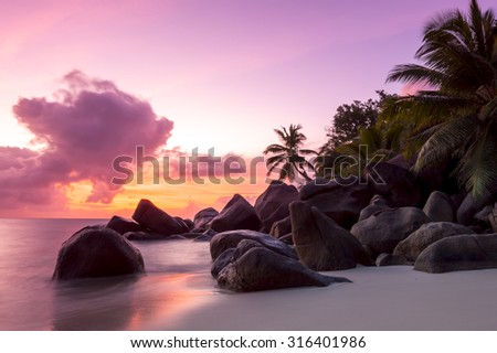 Sunset on tropical beach - Seychelles - nature background - stock photo