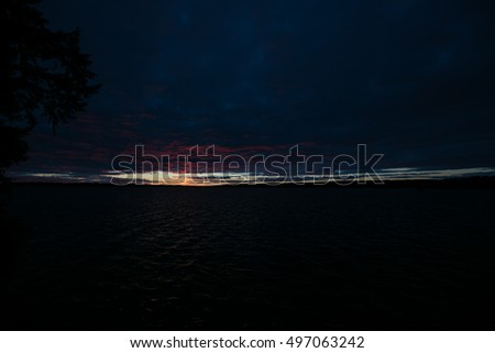 Sunset over a cloudy lake in Canada storm coming in