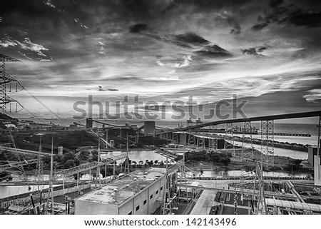 Sunset over a coal materials handling facility - stock photo