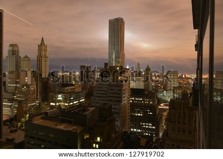 Sunset over a largely dark Manhattan on November 2, 2012, in the midst of the loss of power due to Hurricane Sandy. - stock photo