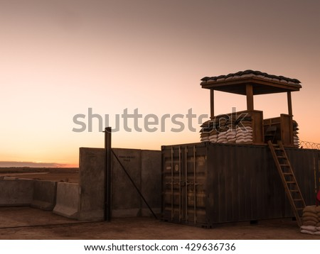 Sunset over a military camp somewhere in the world - stock photo
