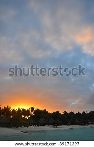 Sunset over a Tahitian Beach - stock photo