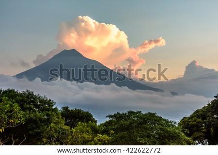 Sunset over Agua volcano near Spanish colonial town & UNESCO World Heritage Site of Antigua, Guatemala, Central America - stock photo