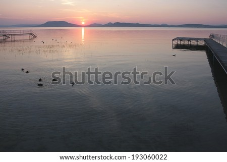 sunset over Badacsony from the southern shore - stock photo