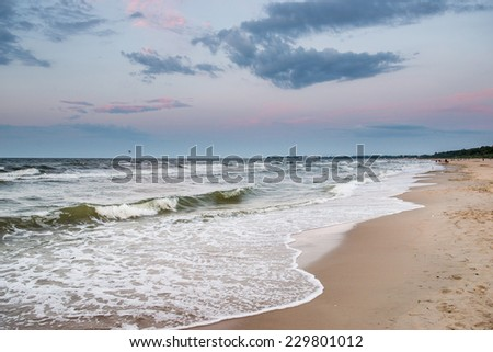 Sunset over Baltic Sea beach in Karlikowo District in Sopot, Poland - stock photo