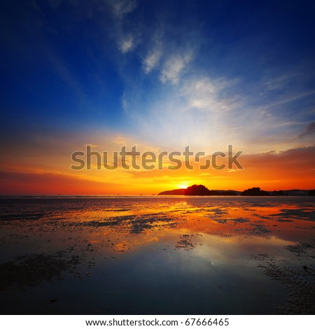 Sunset over beach during ebb - stock photo