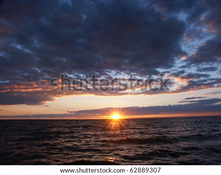Sunset over beautiful Lake Superior in northern Michigan - stock photo