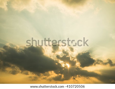 Sunset over beautiful sky with sun shining through clouds