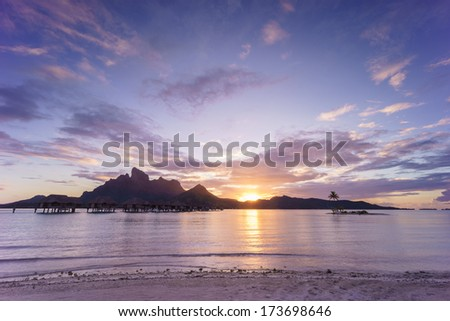 Sunset over Bora Bora - stock photo