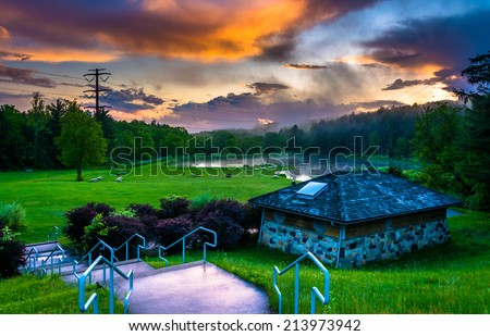 Sunset over building and ponds at Delaware Water Gap National Recreational Area, New Jersey. - stock photo