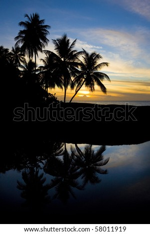 sunset over Caribbean Sea, Turtle Beach, Tobago - stock photo