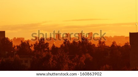 Sunset over city - stock photo