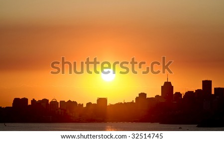 Sunset over city scape - stock photo