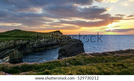 Sunset over cliffs in Cornwall.