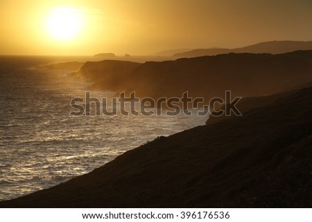Sunset over cliffs on the Wild Atlantic Way in West Cork in Ireland