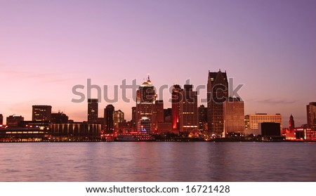 Sunset over Detroit as seen from Windsor, Ontario - stock photo