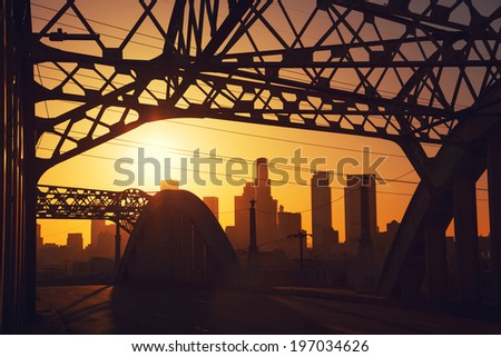 Sunset over downtown Los Angeles city seen from the iconic 6th street Bridge. - stock photo