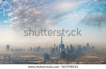Sunset over Dubai, aerial skyline.