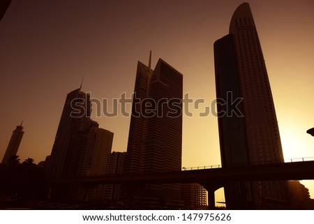 sunset over Dubai city, business center skylines - stock photo